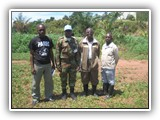 The Benin Battalion MPIO with a representative of the local media and two local community leaders of Kalémie in DR Congo in October 2011.